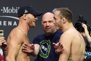 UFC President Dana White (C) looks on as Ryan LaFlare (L) and Tony Martin (R) face off during a ceremonial weigh-in for UFC 229 at T-Mobile Arena on October 05, 2018 in Las Vegas, Nevada. LaFlare and Martin will meet in a welterweight bout at UFC 229 on October 6 at T-Mobile Arena in Las Vegas.