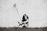A Banksy mural is modified to depict the current COVID-19  pandemic on April 21, 2020 in Southampton, England. The British government has extended the lockdown restrictions first introduced on March 23 that are meant to slow the spread of COVID-19.