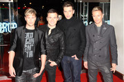 (UK TABLOID NEWSPAPERS OUT) L-R Kian Egan, Shane Filan, Mark Feehily and Nicky Byrne of Westlife attend the UK premiere of This Is It held at the Odeon Leicester Square on October 27, 2009 in London, England.