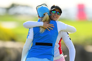 Pernilla Lindberg of Sweden is congratulated after her victory by Jodi Ewart Shadoff of England in the Singles match on day four of the UL International Crown at Jack Nicklaus Golf Club on October 7, 2018 in Incheon, South Korea.