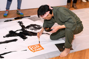 Calligrapher performs as UNIQLO, Nina Agdal and Leigh Lezark Celebrate Store Opening with VIP Event at Hudson Yards, NYC on March 14, 2019 in New York City.
