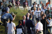 U.S. Golf Association CEO Mike Davis and Brooks Koepka of the United States approach the podium for the trophy ceremony after the final round of the 2018 U.S. Open at Shinnecock Hills Golf Club on June 17, 2018 in Southampton, New York.