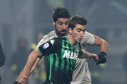 Filip Djuricic of Sassuolo competes for the ball with Sami Khedira of Juventus during the Serie A match between US Sassuolo and Juventus at Mapei Stadium - Citta' del Tricolore on February 10, 2019 in Reggio nell'Emilia, Italy.