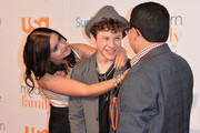 """Actors Ariel Winter, Nolan Gould and Rico Rodriguez attend USA Network's """"Modern Family"""" fan appreciation day at Westwood Village on October 28, 2013 in Los Angeles, California."""
