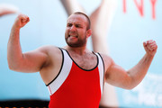 "Tervel Dlagnev of Team USA celebrates after defeating Barsag Kesaev of Russia in a freestyle wrestling match during the 2011 ""Beat The Street"" Gala in Times Square on May 5, 2011 in New York City."