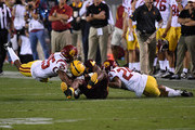 Kyle Williams #10 of Arizona State is tackled by Isaiah Langley #24 and Jack Jones #25 of Southern California during the second half at Sun Devil Stadium on October 28, 2017 in Tempe, Arizona. USC won 48-17.