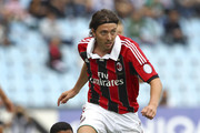 Riccardo Montolivo (R) of AC Milan competes for the ball with Marques Loureiro Allan of Udinese Calcio during the Serie A match between Udinese Calcio and AC Milan at Stadio Friuli on September 23, 2012 in Udine, Italy.