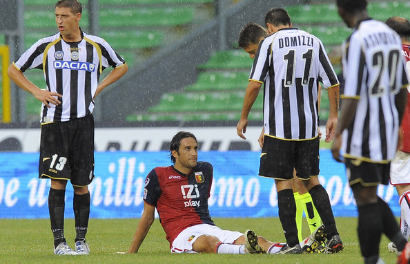 Luca Toni (C) of Genoa lies injured on the turf during the Serie A match between Udinese and Genoa at Stadio Friuli on August 28, 2010 in Udine, Italy.