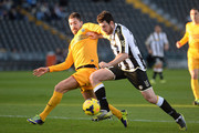 Andrea Lazzari (R) of Udinese Calcio competes for tha ball with Fabrizio Cacciatore  of Hellas Verona FC during the Serie A match between Udinese Calcio and Hellas Verona FC at Stadio Friuli on January 6, 2014 in Udine, Italy.