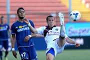 Djamel Mesbah (R) of Livorno Calcio  stetches for the ball next to Roberto Pereyra of Udinese Calcio during the Serie A match between Udinese Calcio and AS Livorno Calcio at Stadio Friuli on May 4, 2014 in Udine, Italy.
