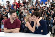 (L-R) Actor Filippo Timi, director Valeria Bruni Tedeschi and actor Louis Garrel attend the 'Un Chateau En Italie' Photocall during The 66th Annual Cannes Film Festival at the Palais des Festivals on May 21, 2013 in Cannes, France.