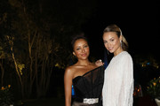 (R-L) Kat Graham and Rose Bertram attend the cocktail at the Unicef Summer Gala Presented by Luisaviaroma at  on August 09, 2019 in Porto Cervo, Italy.