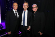 (L-R) Actor Lee Majors, honoree Roy price with The Brass Ring Award, and actor Malcolm McDowell attend United Friends Of The Children Brass Ring Awards Dinner honoring Roy Price and Ande Rosenblum at The Beverly Hilton Hotel on June 2, 2015 in Beverly Hills, California.