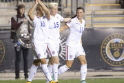Carli Lloyd #10, Megan Rapinoe #15, and Ali Krieger #11 of the United States react after Lloyd scored a goal in the first half against Mexico in the 2014 CONCACAF Women's Championship semifinal game on October 24, 2014 at PPL Park in Chester, Pennsylvania.