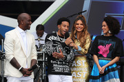 (L-R)  Tyrese Gibson, Ludacris, Maria Menounos and Nathalie Emmanuel speak onstage during Universal Pictures Presents The Road To F9 Concert and Trailer Drop on January 31, 2020 in Miami, Florida.