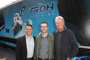 """(L-R) David Levine, vice president/general manager, Disney XD Worldwide, executive producer/director Charlie Bean and  actor Bruce Boxleitner attend the Unveiling Of Disney XD's """"TRON: Uprising"""" Theatre On Wheels At Hollywood & Highland on May 26, 2012 in Hollywood, California."""