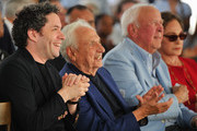 (L-R) Los Angeles Philharmonic Music & Artistic Director Gustavo Dudamel, architect Frank Gehry, and Judith and Thomas L. Beckmen attend the design unveiling of the Judith and Thomas L. Beckmen Yola Center at Inglewood on August 15, 2018 in Inglewood, California.