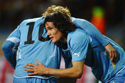 Edinson Cavani of Uruguay (R) celebrates with Diego Forlan as he scores their first goal during the 2010 FIFA World Cup South Africa Third Place Play-off match between Uruguay and Germany at The Nelson Mandela Bay Stadium on July 10, 2010 in Port Elizabeth, South Africa.