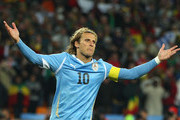Diego Forlan of Uruguay celebrates scoring the first penalty in a penalty shoot out during the 2010 FIFA World Cup South Africa Quarter Final match between Uruguay and Ghana at the Soccer City stadium on July 2, 2010 in Johannesburg, South Africa.