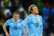 A dejected Diego Forlan of Uruguay prepares to restart the match following the first goal by Sulley Muntari of Ghana during the 2010 FIFA World Cup South Africa Quarter Final match between Uruguay and Ghana at the Soccer City stadium on July 2, 2010 in Johannesburg, South Africa.