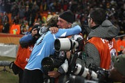Diego Forlan of Uruguay celebrates victory with a photographer after the 2010 FIFA World Cup South Africa Quarter Final match between Uruguay and Ghana at the Soccer City stadium on July 2, 2010 in Johannesburg, South Africa.