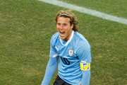Diego Forlan of Uruguay celebrates scoring his team's first goal from a free kick during the 2010 FIFA World Cup South Africa Quarter Final match between Uruguay and Ghana at the Soccer City stadium on July 2, 2010 in Johannesburg, South Africa.