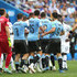 Luis Suarez Nestor Pitana Photos - Uruguay and France players clash during the 2018 FIFA World Cup Russia Quarter Final match between Uruguay and France at Nizhny Novgorod Stadium on July 6, 2018 in Nizhny Novgorod, Russia. - Uruguay vs. France: Quarter Final - 2018 FIFA World Cup Russia