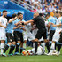 Corentin Tolisso Nestor Pitana Photos - Kylian Mbappe of France lies on the pitch injured while Uruguay and France players argue during the 2018 FIFA World Cup Russia Quarter Final match between Uruguay and France at Nizhny Novgorod Stadium on July 6, 2018 in Nizhny Novgorod, Russia. - Uruguay vs. France: Quarter Final - 2018 FIFA World Cup Russia