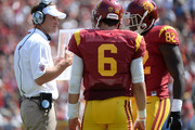 Head coach Lane Kiffin of the USC Trojans talks to Cody Kessler #6 and Randall Telfer #82 during the second quarter against the Utah State Aggies at the Los Angeles Memorial Coliseum on September 21, 2013 in Los Angeles, California.