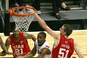 D.J. Gay # 23 of San Diego State shoots the ball against David Foster #51 of Utah during the first half at Cox Arena on February 8, 2011 in San Diego, California.