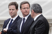 (L-R) Liberal Democrats leader Nick Clegg, Conservative Party leader David Cameron and Labour Party leader and British Prime Minister Gordon Brown attend the VE Day 65th anniversary tributes at the Cenotaph in Whitehall on May 8, 2010 in London, England. The ceremony commemorates Victory in Europe day, declared on 8 May 1945.