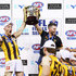 Andrew Moore of the Box Hill Hawks and Box Hill coach Chris Newman celebrate the win with the premiership cup during the VFL Grand Final match between Casey and Box Hill at Etihad Stadium on September 23, 2018 in Melbourne, Australia.