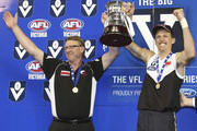 Coach Gerard Fitzgerald and Shaune Moloney celebrate the win after the VFL Grand Final match between North Ballarat and the Northern Bullants at Etihad Stadium on September 19, 2010 in Melbourne, Australia.