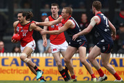 Jake Long of Essendon is tackled by Bernie Vince of the Demons during the VFL Preliminary Final match between Casey and Essendon at North Port Oval on September 15, 2018 in Melbourne, Australia.