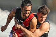 Jake Long of Essendon is tackled during the round eight VFL match between the Northern Blues and Essendon at Ikon Park on May 26, 2018 in Melbourne, Australia.
