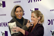 """TV Personalities Nicole Murphy (L) and Jessica Canseco attend """"VH1 Divas"""" 2012 at The Shrine Auditorium on December 16, 2012 in Los Angeles, California."""
