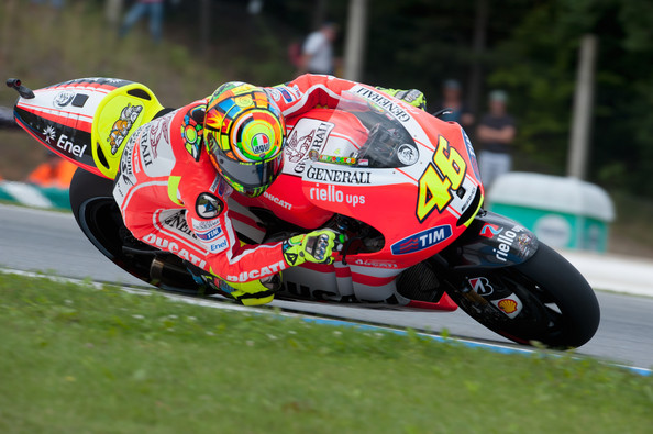 Valentino Rossi Valentino Rossi of Italy and Ducati Marlboro Team rounds a bend during the qualifying practice session ahead of the MotoGp of Czech Republic at Brno Circuit on August 13, 2011 in Brno, Czech Republic.