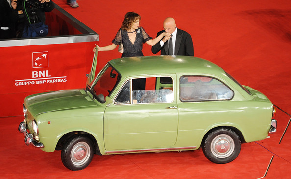 Lancia On The Red Carpet At The Rome Film Fest [land vehicle,vehicle,car,classic car,coup\u00e9,subcompact car,sedan,family car,city car,valeria golino,luca znigarelli,lancia on the red carpet at the rome film fest,italy,rome,la kryptonite kella borsa premiere during the 6th rome film festival at auditorium parco della musica]