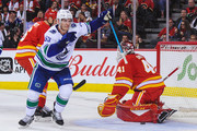 Bo Horvat #53 of the Vancouver Canucks scores a goal on Mike Smith #41 of the Calgary Flames during an NHL game at Scotiabank Saddledome on October 6, 2018 in Calgary, Alberta, Canada.