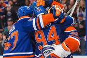 David Perron #57 (L) and Ben Scrivens #30 of the Edmonton Oilers hug Ryan Smyth #94 after they defeated the Vancouver Canucks during an NHL game at Rexall Place on April 12, 2014 in Edmonton, Alberta, Canada.