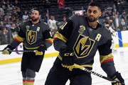 Deryk Engelland #5 and Pierre-Edouard Bellemare #41 of the Vegas Golden Knights skate during warmups before a game against the Vancouver Canucks at T-Mobile Arena on March 20, 2018 in Las Vegas, Nevada. The Golden Knights won 4-1.