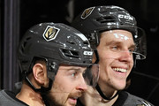 Tomas Tatar (L) #90 and Erik Haula #56 of the Vegas Golden Knights celebrate after Haula assisted Tatar on a goal against the Vancouver Canucks in the second period of their game at T-Mobile Arena on March 20, 2018 in Las Vegas, Nevada. The Golden Knights won 4-1.
