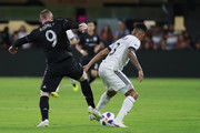 Wayne Rooney #9 of D.C. United and Sean Franklin #3 of Vancouver Whitecaps battle for the ball in the second half at Audi Field on July 14, 2018 in Washington, DC. Rooney made his MLS debut.