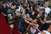 Max Pacioretty #67 of the Vegas Golden Knights signs autographs for fans as he arrives at the Vegas Golden Knights Fan Fest at the Downtown Las Vegas Events Center on September 19, 2018 in Las Vegas, Nevada.