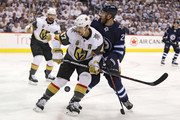 Luca Sbisa #47 of the Vegas Golden Knights and Paul Stastny #25 of the Winnipeg Jets battle for the puck during the second period in Game Two of the Western Conference Finals during the 2018 NHL Stanley Cup Playoffs at Bell MTS Place on May 14, 2018 in Winnipeg, Canada.
