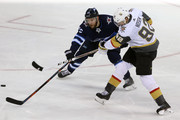 Tomas Nosek #92 of the Vegas Golden Knights shoots against Paul Stastny #25 of the Winnipeg Jets during the second period in Game Two of the Western Conference Finals during the 2018 NHL Stanley Cup Playoffs at Bell MTS Place on May 14, 2018 in Winnipeg, Canada.