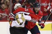 Devante Smith-Pelly #25 of the Washington Capitals and Max Pacioretty #67 of the Vegas Golden Knights  jostle during the second period at Capital One Arena on October 10, 2018 in Washington, DC.