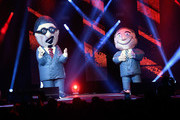 Blow up characters of Penn Jillette (L) and Teller of the comedy/magic team Penn & Teller perform at the Vegas Strong Benefit Concert at T-Mobile Arena to support victims of the October 1 tragedy on the Las Vegas Strip on December 1, 2017 in Las Vegas, Nevada.