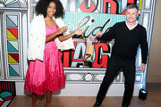 Jessica Williams (L) and President of Verizon Consumer Group Ronan Dunne co-host Verizon's More Holiday Magic Event at Manhatta on December 05, 2019 in New York City.