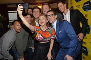 """Actress Kristen Bell (C) poses for a selfie with cast members (L-R) Percy Daggs, Enrico Colantoni, Chris Lowell, Ryan Hansen, Jason Dohring and director Rob Thomas at the premiere of """"Veronica Mars"""" during the 2014 SXSW Music, Film + Interactive Festival at the Paramount Theatre on March 8, 2014 in Austin, Texas."""
